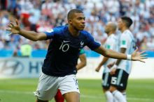 Kylian Mbappe 'happy' after his brace helps France beat Argentina but says Pele is 'on another level'