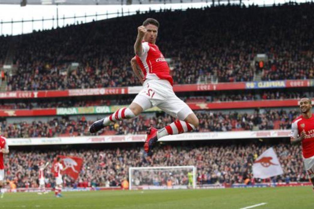 PENUH KEYAKINAN DIRI: Penyerang asal Perancis, Olivier Giroud, meraikan gol pertama yang dijaringkannya semasa menentang West Ham hujung minggu lalu. - Foto AFP