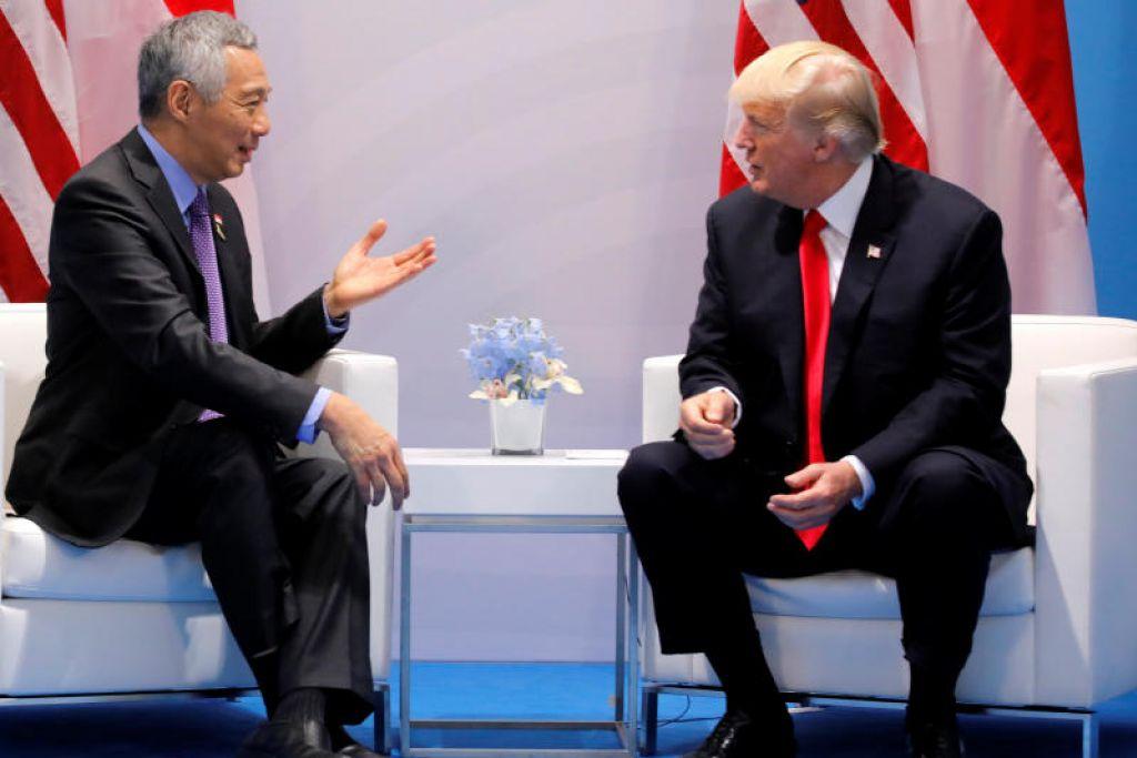 PERTEMUAN DUA HALA PERTAMA: PM Lee dan Encik Trump mengadakan pertemuan dua hala pertama di luar acara Sidang Puncak G-20 di Hamburg, Jerman pada Julai 2017.