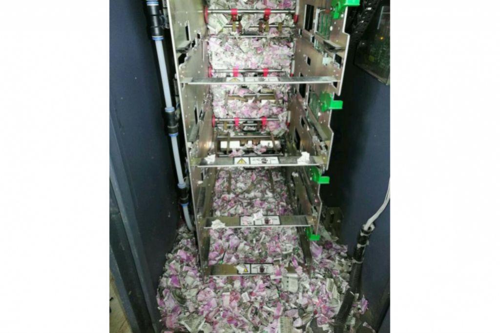 DIGIGIT TIKUS: Gambar yang diambil pada 19 Jun 2018 ini menunjukkan wang kertas berjumlah 1.2 juta rupee ($24,055) dalam cebisan kecil selepas digigit tikus.