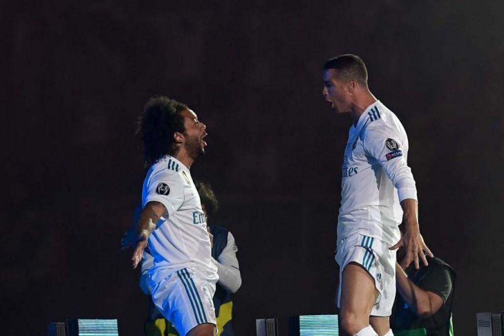 Marcelo (kiri) dan Ronaldo menyambut kejayaan Real Madrid menjuarai Piala Juara-Juara pada May 2018.