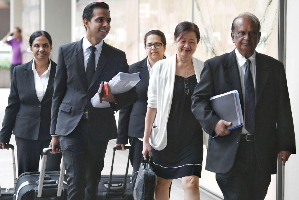 HADIR: Cik How Weng Fan (dua dari kanan) dari FM Services & Solutions tiba di Mahkamah Agung bersama pasukan peguamnya semalam. - Foto BH oleh KHALID BABA