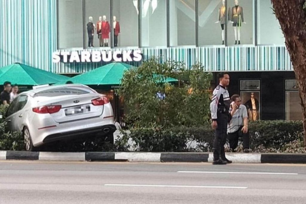 Taxi mounts Orchard Road pavement in early morning accident